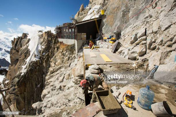 Specialist construction workers on the Aiguille Du Midi above Chamonix, France.