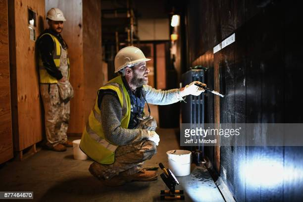 Specialist craftsmen reinstate wood panelling on the ground floor of the Mackintosh Building on November 22 2017 in Glasgow Scotland Restoration of...