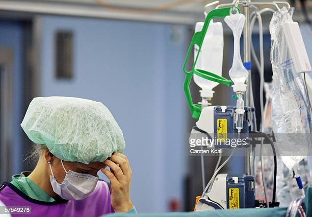 Specialist doctor for anesthesia looks at the equipment during surgery in the clinic for surgery and orthopedics of the Martin Luther University...