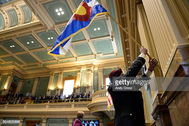Specialist John Haubert Colorado Army National Guard 5th Battalion 19th Special Forces group Airborne posts the Colorado Flag on the House floor to...