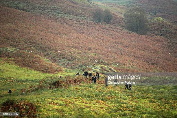 A specialist police search team scours the heathland and hills surrounding the town of Machynlleth in their quest to find missing fiveyearold April...