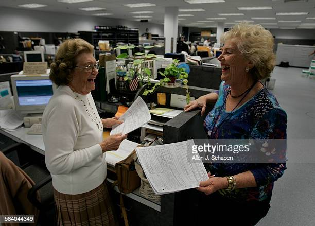 Specialist reserve police officers Billie O'Donnell left and Ruth Goldman share a laugh while they do paperwork in the detective department Wednesday...