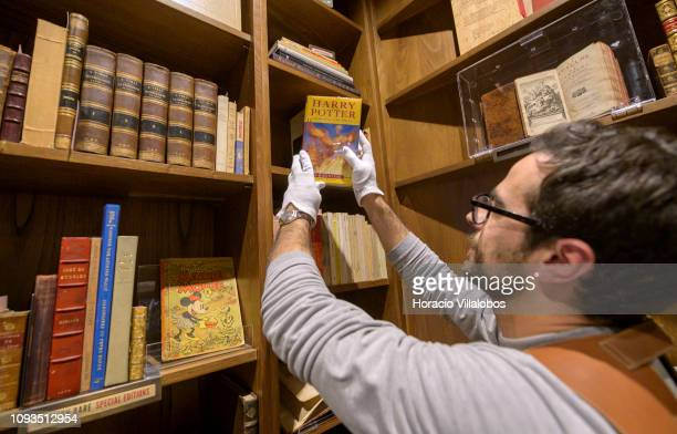 Specialist Rui Moutinho handles an autographed copy of Harry Potter and the Order of the Phoenix at Sala Gemma in Lello Bookstore on the eve of its...