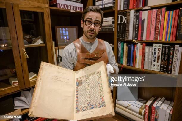 Specialist Rui Moutinho shows a 1478 copy of the Law treaty by Bartolo Sassoferrato valued in 9500 euros at Sala Gemma in Lello Bookstore on the eve...