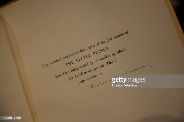 Specialist Rui Moutinho shows a copy of an autographed first edition of The Little Prince by Anoine de SaintExupery valued in 25000 euros at Sala...