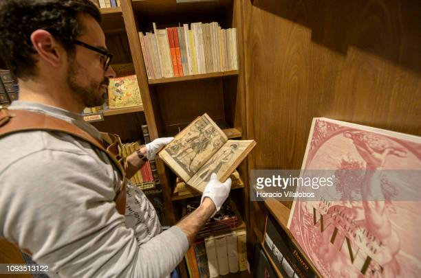 Specialist Rui Moutinho shows a copy of Os Lusiadas by Luis Vaz de Camoes at Sala Gemma in Lello Bookstore on the eve of its 113th anniversary on...