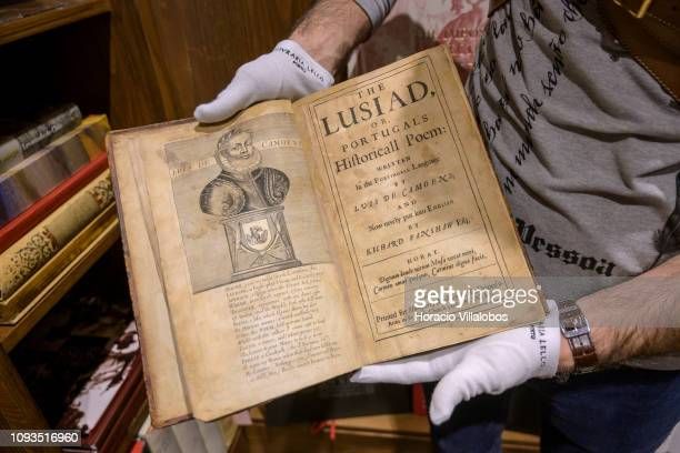 Specialist Rui Moutinho shows a copy of the first English edition of The Lusiad by Luis Vaz de Camoes valued in 18000 euros at Sala Gemma in Lello...