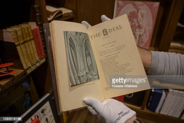 Specialist Rui Moutinho shows a copy of TS Eliot The Dial at Sala Gemma in Lello Bookstore on the eve of its 113th anniversary on January 12 2019 in...