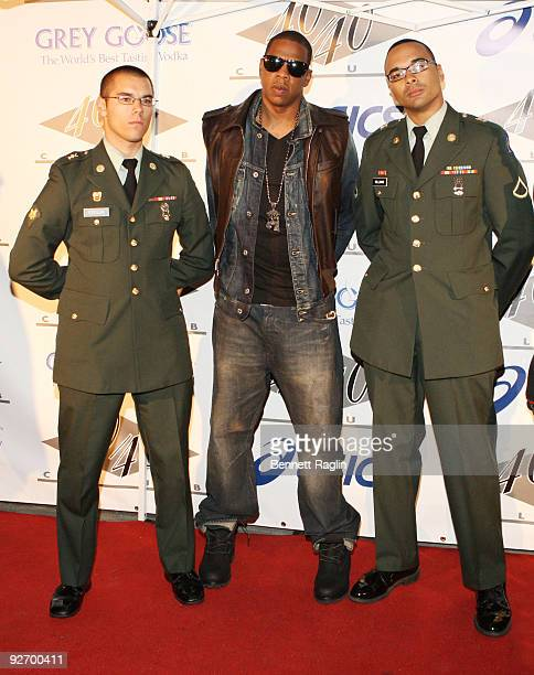 Specialist Tony Sdeglik JayZ and PFC Gregory Williams attend the official 2009 MTV Video Music Awards after party at 40 / 40 Club on September 13...