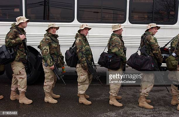 Specialist US soldiers with the 102nd Field Artillery Massachusetts National Guard unit prepare boards a bus to begin his deployment to Kuwait and...