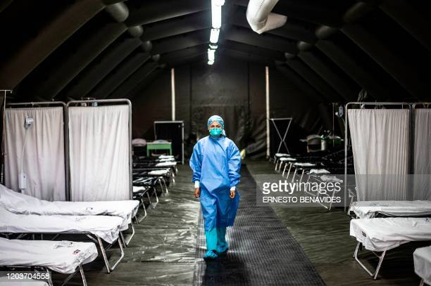 TOPSHOT A specialist walks inside a mobile unit set up by the Peruvian Ministry of Health as a preventive measure if a case of the COVID19 virus...