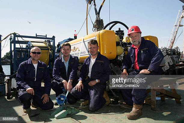 Specialists of British submarine rescue team Nygel Pyne Markus Cave David Burke and Charlie Sillett pose for a picture in front of their underwater...