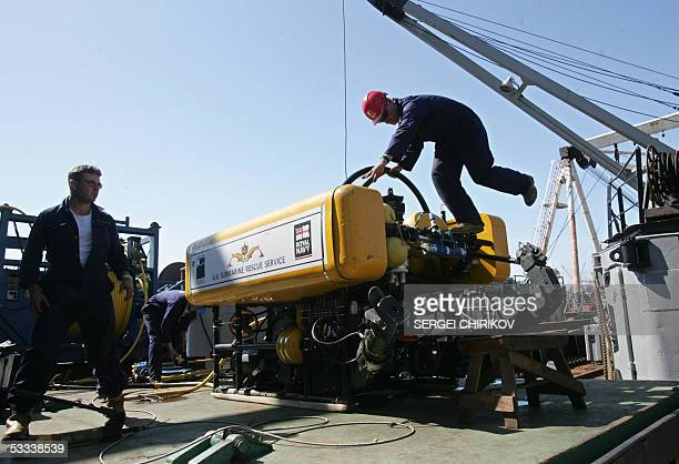 Specialists of British submarine rescue team unload their underwater robotic mashine Scorpio from a Russian ship as they successfully solved a very...