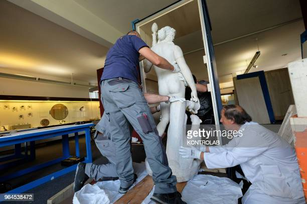 Specialists work to set up the exhibition 'L'Immagine Invisibile at Archeological Museum in Paestum southern Italy The exhibition shows paintings...
