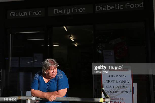 Speciality food shop owner Georgina stands oustide her Celiac Supplies store in the suburb of Coorparoo on March 28 2013 in Brisbane Australia The...