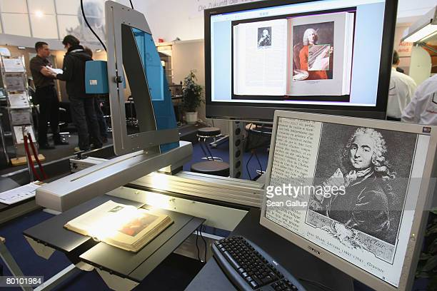 Specialized scanner for scanning books scans a rare book at the Zeutschel Digibook stand at the CeBIT technology fair the first day the fair opened...