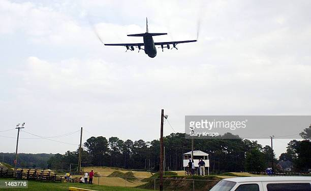 A specially equipped C130 Hercules from the Air Force Reserve's 757th Airlift Squadron out of Youngstown Ohio sprays Dibrome Concentrate from its...