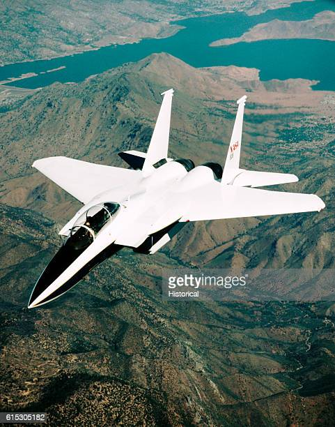 A specially modified F15B Eagle in flight over the California desert The aircraft is being used to test the effects of weather on heat resistant...