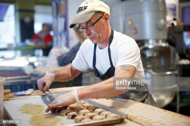 Specialty Baker John Amichetti places the cookies on the cookie sheets to be baked while preparing the day's rugelach at Blacker's Bakeshop in Newton...
