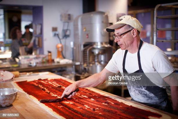 Specialty Baker John Amichetti spreads raspberry filling on the rugelach dough while preparing the day's rugelach at Blacker's Bakeshop in Newton MA...