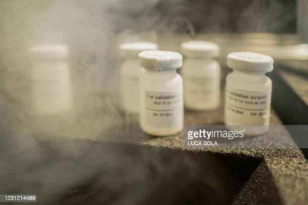 Specimens of premixed saline solution designed to mimic the a COVID-19 vaccine are seen on the top of a prototype of Cryo-Vacc, an ultra-cold...