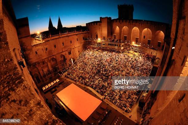 TOPSHOT Spectactors attend 'The damned' play by Luchino Visconti directed by Ivo Van Hove on July 6 2016 in the courtyard of honour of the Palais des...