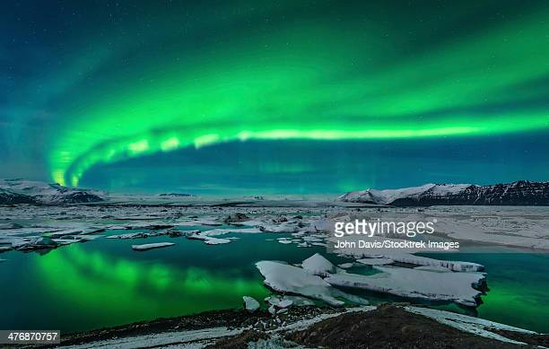 Spectacular aurora display over the glacier lagoon Jokulsarlon in Iceland.