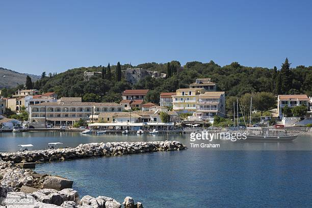 Spectacular beach resort and harbour of Kassiopi with blue sky and turquoise Ionian Sea Corfu Ionian Islands of Greece