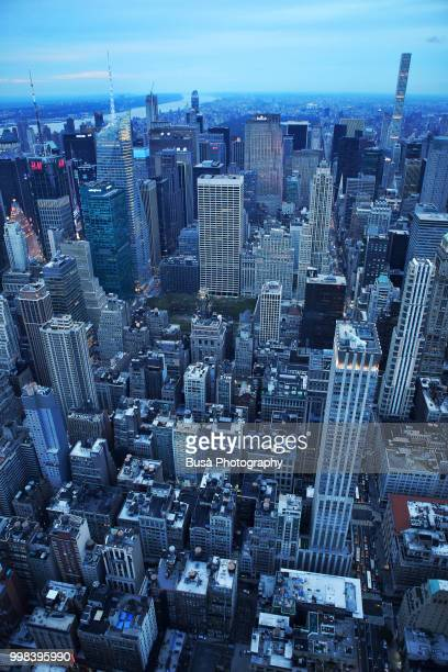 Spectacular bird's eye view of Manhattan at twilight: Times Square, General Electric Building, Rockefeller Center, 432 Park Avenue. New York City, USA