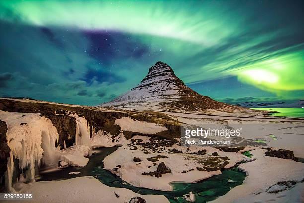 Spectacular celestial lights Aurora Borealis above Kirjuffell, Iceland