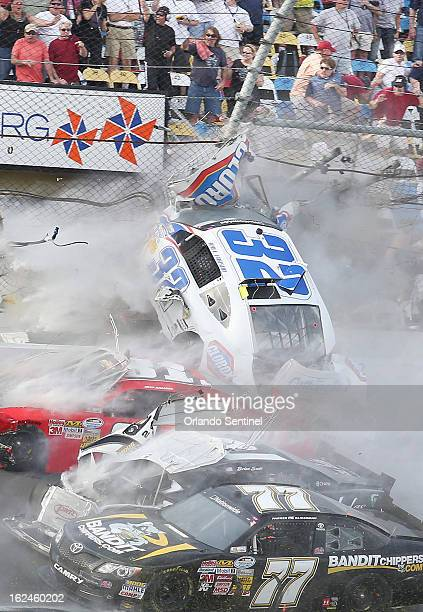 A spectacular crash involving the car of Kyle Larson sends the car into the catch fence and grandstands on the last lap of the DRIVE4COPD 300...