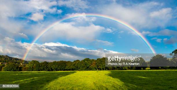 spectacular double rainbow - rainbow stock pictures, royalty-free photos & images