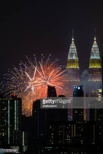 spectacular fireworks display mark the nation's 62 years of independence of malaysia. - shaifulzamri stock pictures, royalty-free photos & images