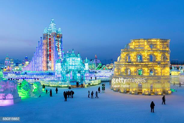 spectacular illuminated ice sculptures at the harbin ice and snow festival in harbin, heilongjiang province, china, asia - harbin stock pictures, royalty-free photos & images