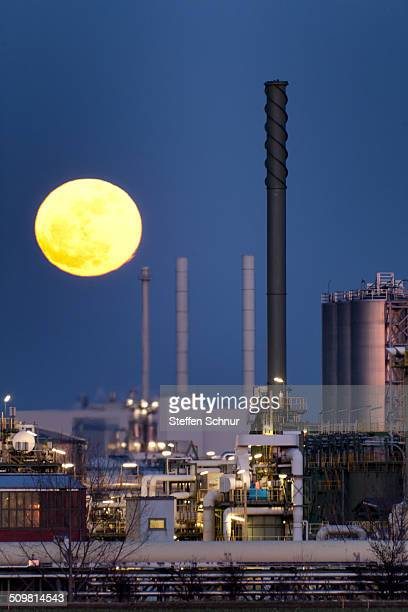 Spectacular moonrise over an industrial plant in Germany