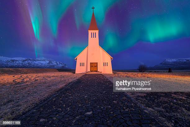 spectacular northern lights appear over church - marginata stock pictures, royalty-free photos & images