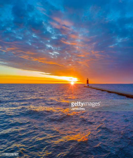 spectacular northern sunrise sky with violent waters. - upper peninsula stock pictures, royalty-free photos & images