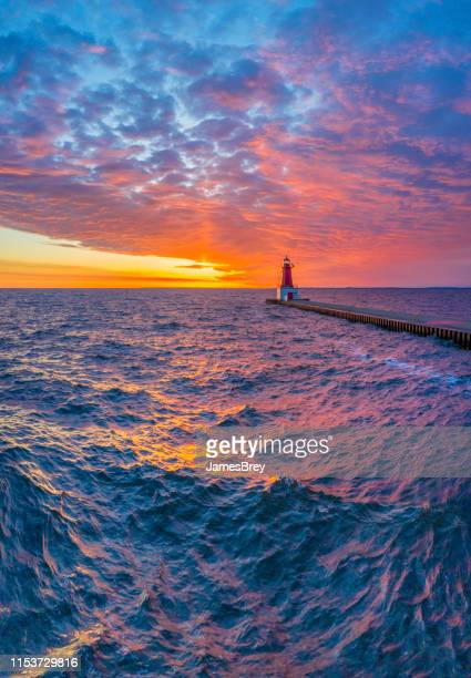 spectacular northern sunrise sky with violent waters. - great lakes stock pictures, royalty-free photos & images