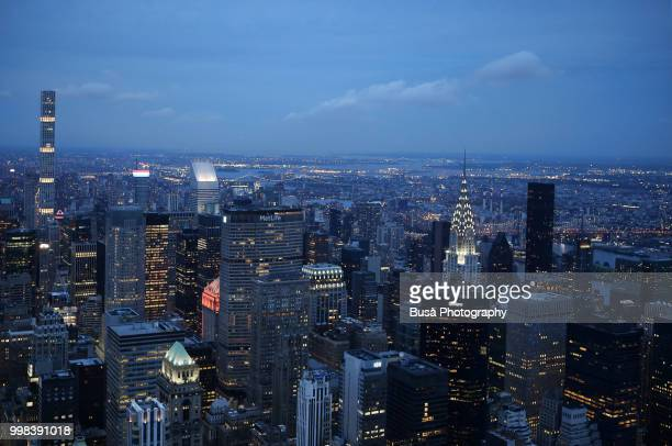 Spectacular panoramic view from atop the Empire State Building at twilight: 432 Park Avenue, the Metlife Building and the Chrysler Building. New York City, USA