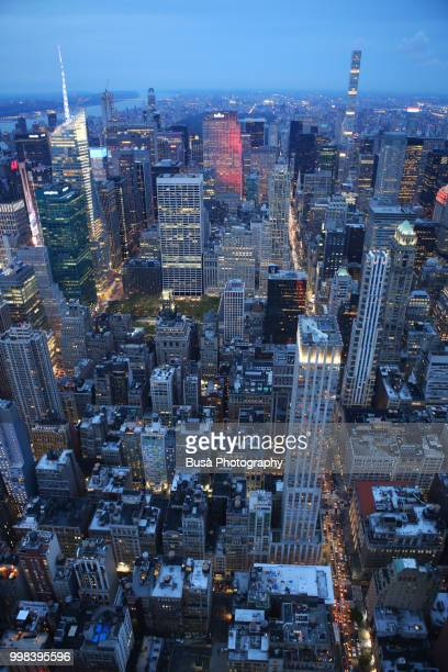 Spectacular panoramic view from atop the Empire State Building at twilight: Times Square, General Electric Building, Rockefeller Center, 432 Park Avenue. New York City, USA