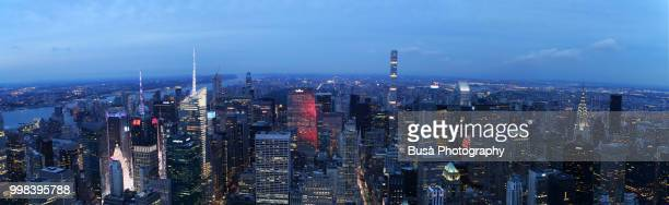 Spectacular panoramic view from atop the Empire State Building at twilight: Times Square, General Electric Building, Rockefeller Center, 432 Park Avenue, Metlife Building, Chrysler Building. New York City, USA