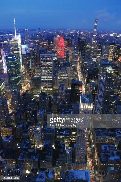 Spectacular panoramic view from atop the Empire State Building at twilight: Times Square, Rockefeller Center, Bryant Park, 432 Park Avenue. New York City, USA