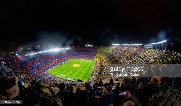 December 18: A spectacular panoramic view of Nou Camp Stadium as fans hold coloured placards before the start of the Barcelona V Real Madrid, La Liga...
