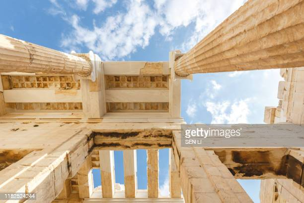 spectacular sights of the ruins in ancient greek acropolis, old temple of parthenon and stone pillar columns - パルテノン神殿 ストックフォトと画像
