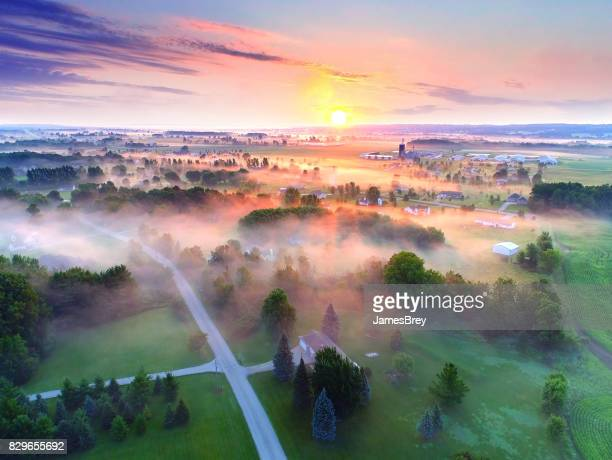 Spectacular sunrise over foggy rural landscape, aerial view