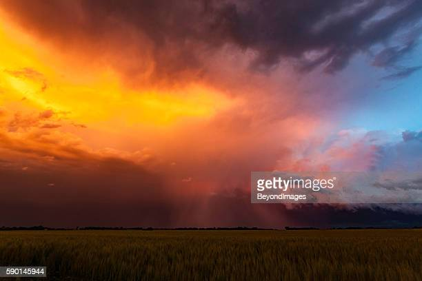 spectacular sunset colours on storm clouds in tornado alley - storm cloud stock pictures, royalty-free photos & images