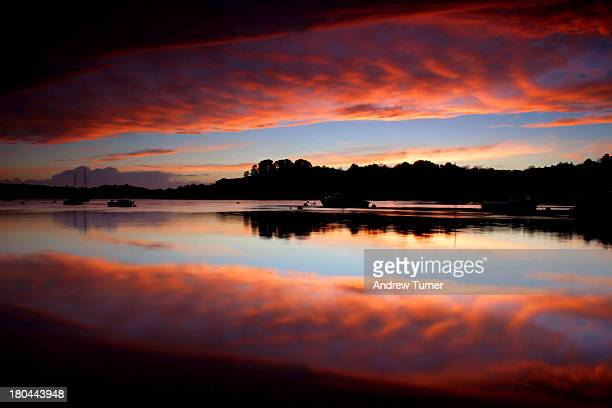 Spectacular sunset near to Saltash is reflected in the Tamar estuary.