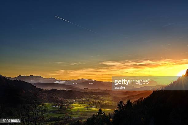 spectacular sunset over landscape at European alps in autumn
