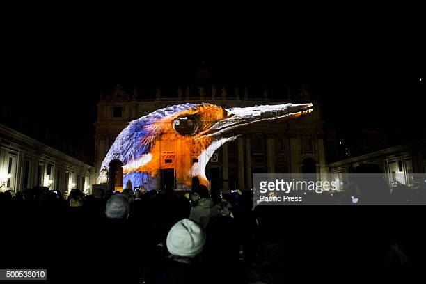 A spectacular video mapping projection at the facade of St Peter's Basilica in the Vatican representing the creation of nature and other religious...
