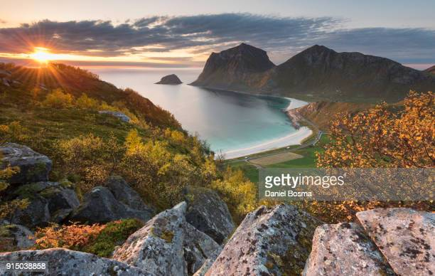 spectacular view during sunset down to haukland beach from a mountain, surrounded by bright autumn colors - atlantic road norway photos et images de collection